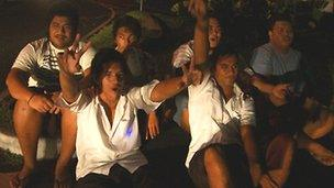 Boys in Samoa celebrate time zone change. Still from video by Rico Tupai.