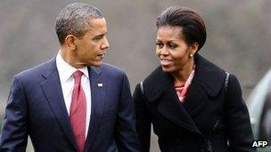 President Barack Obama and First Lady Michelle Obama walk to the White House on 14 December 2011