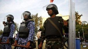 Maldives Military and Maldives police force guard the security force building in Male, Maldives, Tuesday, Jan. 17, 2012.