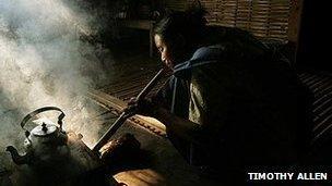 A Khasi woman cooking