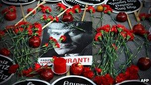 Red carnations surround a photo of Hrant Dink outside the Agos newspaper offices in Istanbul, 19 January
