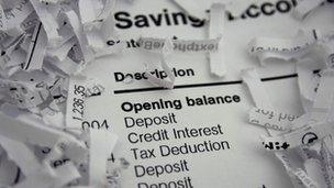 A bank statement and shredded documents