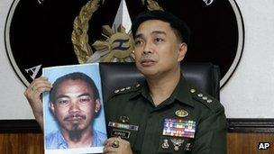 Armed Forces of the Philippines spokesman Col. Marcelo Burgos shows a picture of Malaysian Zulkipli bin Hir, also known as Marwan, a top leader of Jemaah Islamiyah, during a press conference Thursday, Feb. 2, 2012 in suburban Quezon City, north of Manila, Philippines.
