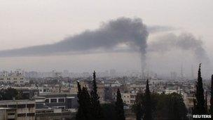 Smoke billows in Homs (handout picture received February 17, 2012)