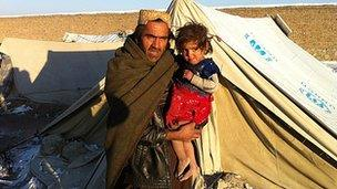 Samar Gul with his daughter
