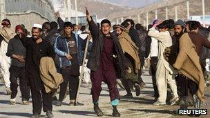 Afghan protesters gesture towards police in Kabul on 24 February
