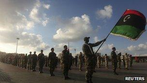 Soldiers from the National Army of Cyrenaica take part in a military parade graduation ceremony in Benghazi on 3 march 2012
