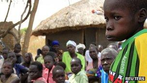Watum Kenneth, 13, who suffers from nodding syndrome, stands in Akoya-Lamin Omony village, Uganda