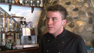 Marcel in the Swiss restaurant where he works