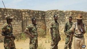In this Wednesday, Feb. 29, 2012 file photo taken in Somalia, Ethiopian soldiers patrol in the town of Baidoa in Somalia.