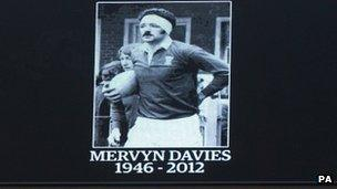 Image of Mervyn Davies on the big screen during the minute's silence