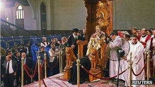 The body of Pope Shenouda seated in his papal chair during public viewing - 18 March