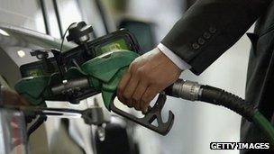 A man using a petrol pump