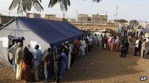 Voters wait to cast their votes in in the Guediawaye neighborhood of Dakar, Senegal, on 25 March 2012