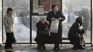 Women wait at a bus stop in Estonia