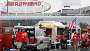 Tailgating party in the parking lot at Kansas City Chiefs stadium