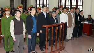 Nine former senior executives of the state-owned Vietnamese shipbuilding group Vinashin, including former company boss Pham Thanh Binh, on trial in the northern city of Hai Phong on 27 March 2012.