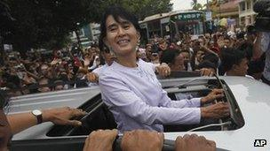 Aung San Suu Kyi surrounded by supporters in Rangoon on 2 April 2012