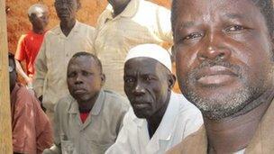South Sudanese men, including chief Carlo Musa
