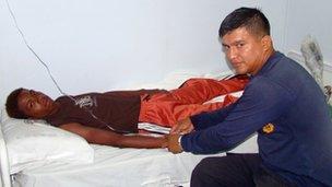 Adrian Vasquez receives medical attention aboard an Ecuadorean navy ship offshore Galapagos Islands, 25 March 2012