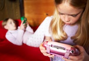 Girls playing electronic games