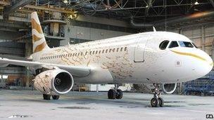 BA gold-painted aircraft