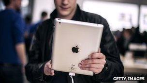 A man holds the latest Apple iPad