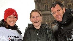 Claire Lomas (middle) with Gabby and Kenny Logan on Tower Bridge, London