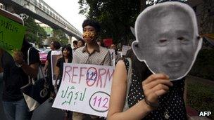 Thai activists stage a march against the country's widely-criticised laws protecting the monarchy, in Bangkok on 10 December, 2011