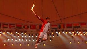 Li Ning is lifted to light the Olympic Flame for the 2008 Beijing Summer Olympics