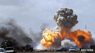 Explosions follow a Nato air strike on forces loyal to Muammar Gaddafi between Benghazi and Ajdabiyah, 20 March 2011