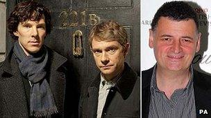Steven Moffat (r) next to a still depicting Sherlock stars Benedict Cumberbatch and Martin Freeman
