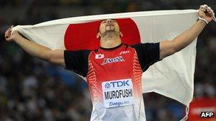 Japan's Koji Murofushi celebrates victory