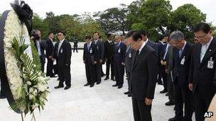 South Korean President Lee Myung-bak, center, pays a silent tribute to the victims of a bloody 1983 attack staged by North Korean commandos against visiting South Korean dignitaries, in Rangoon, Burma on 15 May, 2012