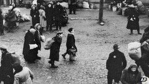 Jews are gathered at an assembly point in the Kaunas ghetto for deportation.