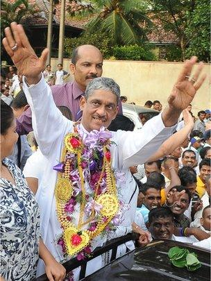 """Sri Lanka""""s former army chief Sarath Fonseka gestures to supporters from a car as he leaves the main prison in Colombo on May 21, 2012."""