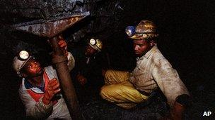 Miners work underground at the Harmony Goldmine, near Carletonville, South Africa, Wednesday 27 October 2004