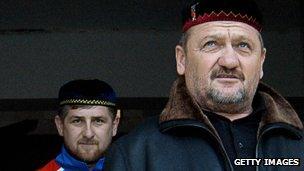 Chechen leader Akhmad Kadyrov, right