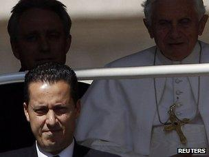 The Pope's butler, Paolo Gabriele (bottom left) arrives with Pope Benedict at the Vatican (23 May 2012).