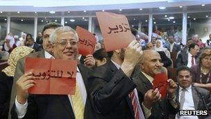 Delegates from the Green Algeria alliance, a grouping of moderate Islamist parties with links to the ruling establishment, hold up placards during the opening session of the new National Assembly in Algiers May 26, 2012