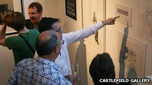 People viewing work in the Castlefield Gallery
