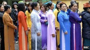 Vietnamese women queuing at Ho Chi Minh's mausoleum