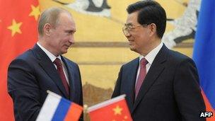 Chinese President Hu Jintao and his Russian counterpart Vladimir Putin shake hands during a signing ceremony at the Great Hall of the People in Beijing on 5 June, 2012