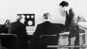 Turing stands next to Ferranti Mark I