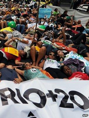 Activists lie on Rio Branco in Rio de Janeiro