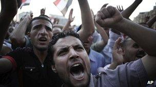 Men chant anti-Supreme Council for the Armed Forces (Scaf) slogans in Tahrir Square in Cairo - 21 June, 2012