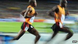 Uganda's Jacob Araptany and Uganda's Benjamin Kiplagat compete during the men's 3,000m steeplechase final at World Championships in Daegu on 1 September 2011