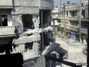 Photo taken by opposition activists purportedly showing damage in Homs (20 June 2012)
