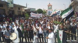 Anti-government demonstrators at a rally in Idlib, Syria