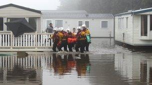 Lifeboat crews are helping people from a caravan at Cayton Bay caravan park in North Yorkshire